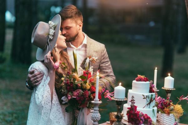 beautiful couple on wedding standing near cake and candles picture id916028402 1